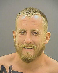 Baltimore police arrested Mark Harvey, 26, of Severn at Sunday's Ravens game after he jumped onto the field.