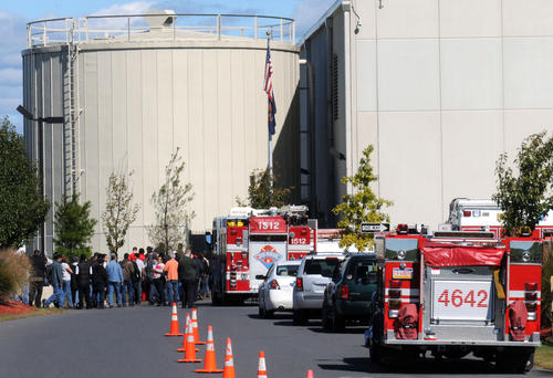 Trader Joe's warehouse employees stand near fire trucks after a carbon monoxide leak on Sunday at Trader Joe's warehouse on Silvercrest Road in East Allen Township. Eighteen  workers were taken to a hospital for evaluation.