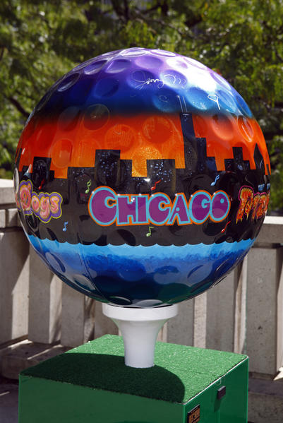"""Chicago's Best"" by Jeff Budzban is one of about 50 oversize decorated golf balls lining Michigan Avenue to celebrate the 39th Ryder Cup golf tournament in Medinah, Illinois."