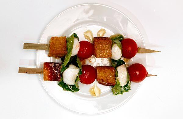 Panzanella salad on skewers.