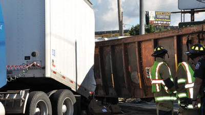 CSX hits truck trailer at crossing