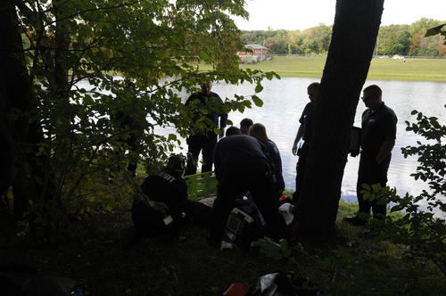 Students in the New Britain Emergency Medical Services Academy Paramedic training course learn out in the field as they work on a mannequin which represents a person found injured on the bank of the pond at Stanley Quarter Park in New Britain Monday afternoon.