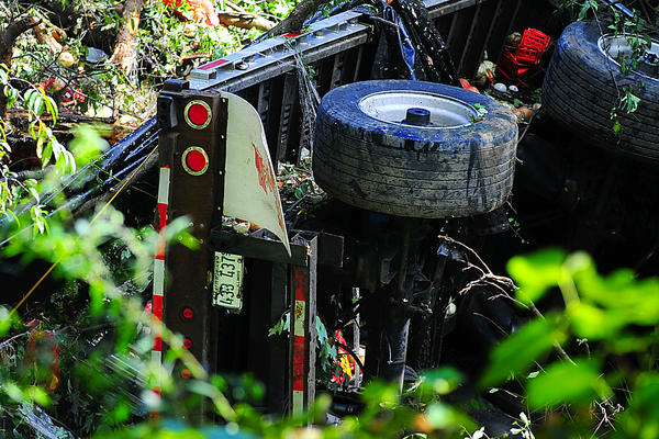 A tractor-trailer skidded down a steep embankment Monday near Interstate 68, west of Hancock, and came to rest at the bottom of a ravine.