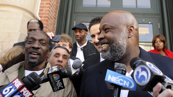 Ronald Taylor, left, and George Gould rejoice in front of Rockville Superior Court on April 1, 2010, after a judge overturned their convictions in a 1993 murder. Taylor died of cancer in October 2011, and Gould is back in prison after the state Supreme Court overruled the judge who freed them.