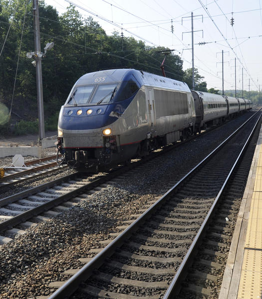 An Acela train passes through the BWI station.