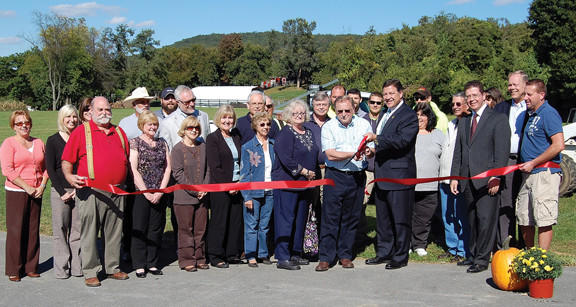 Quincy Township Supervisors, Franklin County Commissioners and U.S. Rep. Bill Shuster are joined by Washington Township officials, local chamber of commerce officials and area business people during a ribbon-cutting ceremony Monday for a new park in Quincy Township, Pa.