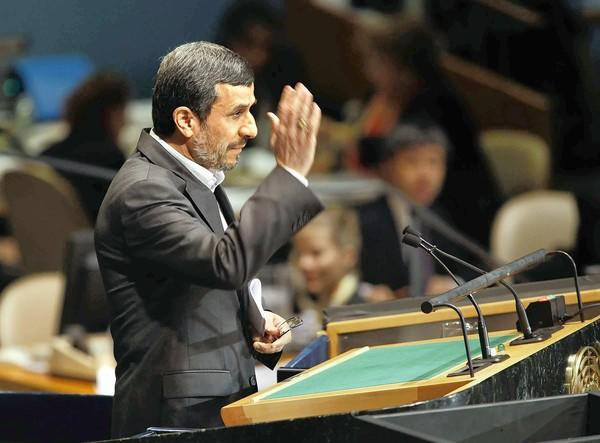 Iranian President Mahmoud Ahmadinejad waves after speaking at a United Nations meeting.