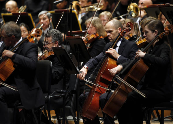 The Chicago Symphony Orchestra performs at Pritzker Pavilion in Millennium Park.