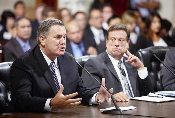 Tim Leiweke, left, chief executive of AEG, and Gerry F. Miller, right, chief legislative analyst with the City Council, answer questions about the proposed Farmers Field on Monday at City Hall.