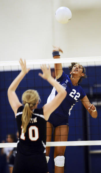 Williamsport's Stacey Christy goes up for a return during Monday night's match against North Hagerstown.