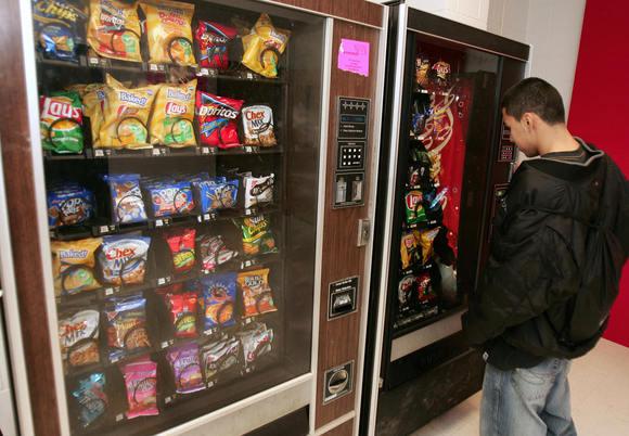 Student picks snack from vending machine