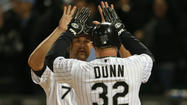 Adam Dunn couldn't stop smiling. He was floating, levitating almost, as he talked about how all the years of his baseball career — including one of the longest seasons anyone has ever had — had led to two swings of his bat Monday night.