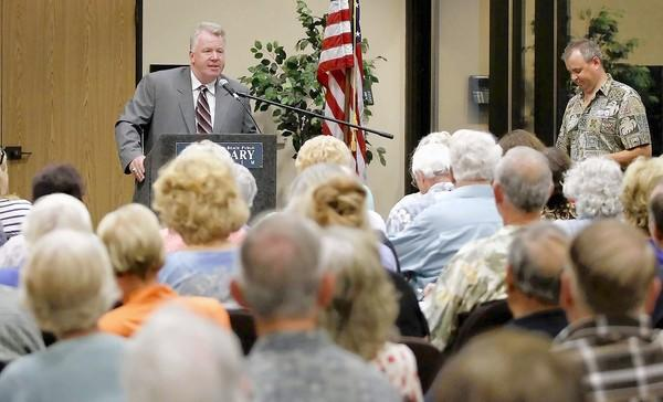 Candidate Billy O'Connell answers questions to a packed house during the Surf City Tea Party candidates forum for Huntington Beach City Council at the Central Library on Monday.