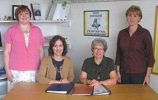 Seated, from left, Celia Torres, home-school program director and NILD therapist at Broadfording Christian Academy, and Linda Higgins, home-school administrator and Orton-Gillingham tutoring specialist. Standing, Julie Malecki, autism home school reviewer, and Christy Spicer, HOPE program director.