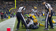 SAN DIEGO - Social media erupted Monday night after the Seattle Seahawks' rookie quarterback lofted a controversial touchdown pass to the end zone as time ran out, giving the Seahawks a wild win over the Green Bay Packers.