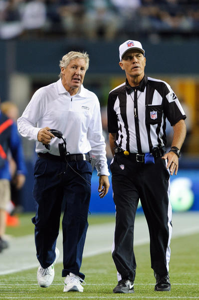 Seattle Seahawks head coach Pete Carroll talks with a referee during the 2nd half against the Green Bay Packers at CenturyLink Field. Seattle defeated Green Bay 14-12.