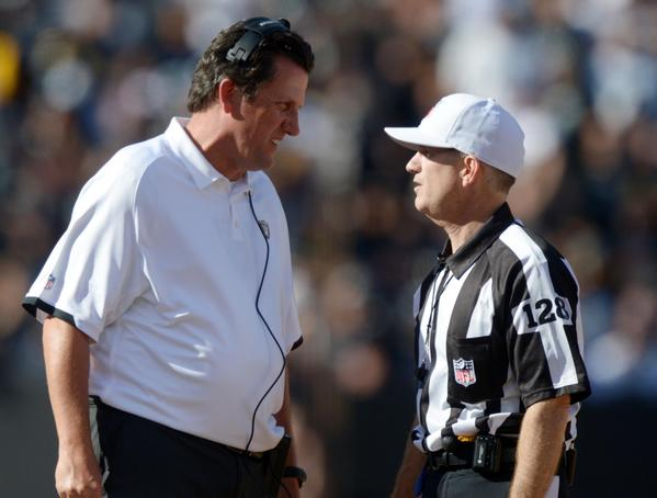 Oakland Raiders offensive coordinator Greg Knapp (left) talks with replacement referee David White (128) during the game against the Pittsburgh Steelers at the O.co Coliseum. The Raiders defeated the Steelers 34-31.