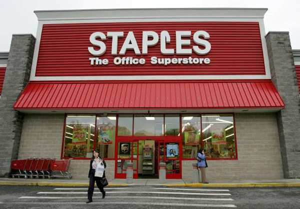 Staples will speed up store closures and invest more in its online operations.