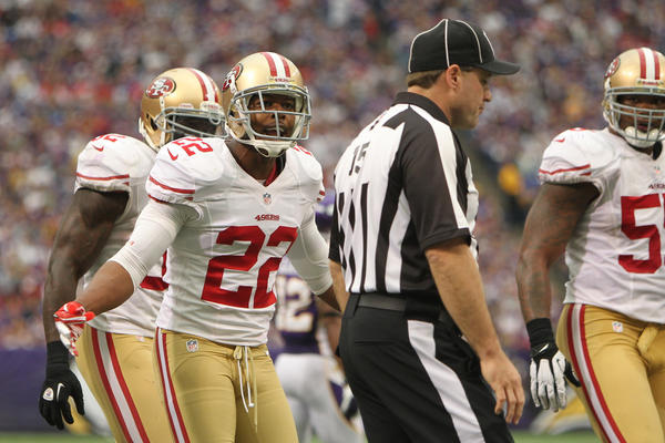 San Francisco 49ers defensive back Carlos Rogers (22) argues a call with referee Brian Burkhart (15) during the third quarter against the Minnesota Vikings at the Metrodome. The Vikings defeated the 49ers 24-13.
