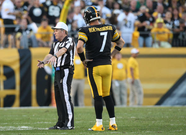 Referee Jerry Frump (37) calls Pittsburgh Steelers quarterback Ben Roethlisberger (7) for intentional grounding against the New York Jets during the second half of the game at Heinz Field. The Steelers won the game, 27-10.