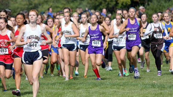 Katelyn Dreyer (l) finished 11th overall at the Delta Invitational Saturday to lead her team to a division 2 victory.