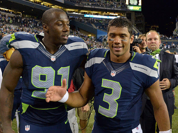 Seattle Seahawks quarterback Russell Wilson (3) and defensive end Chris Clemons (91) celebrate after the game against the Green Bay Packers at CenturyLink Field. The Seahawks defeated the Packers 14-12.