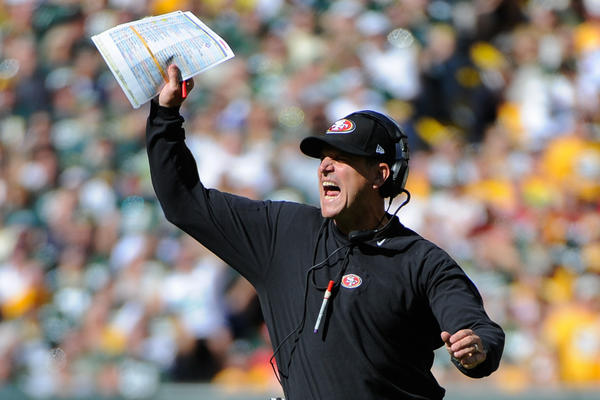 San Francisco 49ers head coach Jim Harbaugh shouts at a referee during the game against the Green Bay Packers at Lambeau Field.