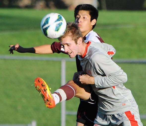Parkland's Steven Guetzlaff heads the ball in front of Stroudsburg's Nicola Scattolon.