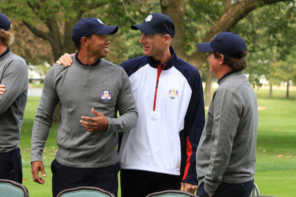 USA Ryder Cup Team members Tiger Woods, left, Jim Furyk and Jason Dufner kid around during a team photo session at Medinah Country Club this morning.