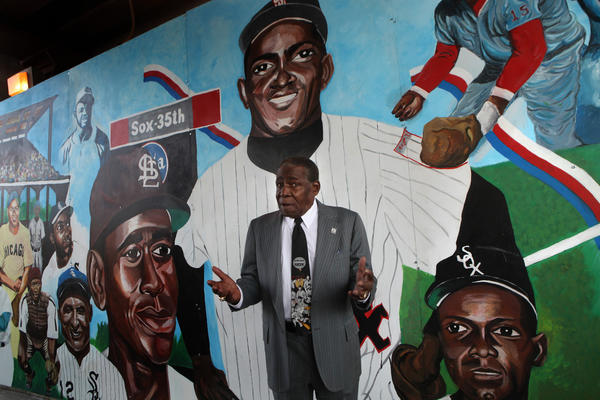 Chicago White Sox great Minnie Minoso, 82, visits the mural that features him prominently as the largest figure, player directly behind him, in a series of African American ballplayers that was unveiled Tuesday on 35th Street below the Metra tracks at Federal.