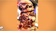 "<span style=""font-size: small;"">Hey burger fans, have you heard of the ""Stellanator?"" Well, we haven't either! But Molly Schuyler, a woman from Bellevue, Nebraska just made history as the first woman to dominate eating this notorious sandwich at Stella's Bar and Grill. The ""Stellanator"" consists of six hamburger patties, six eggs, six pieces of cheese and six pieces of bacon. To top that off, there are fried onions, a mound of jalapenos, lettuce, tomatoes, pickles, two buns and mayonnaise. Finally, there's practically an entire jar of peanut butter. She is only the 9 th person to overcome the task that over 200 people have failed before her—and she ate this entire sandwich in 15 minutes! It was the 2 nd in fastest time on record, beaten only by a professional eating competitor. The ""Stellanator"" even failed to fill Schuyler as she finished off her kids meals after as well!</span>"
