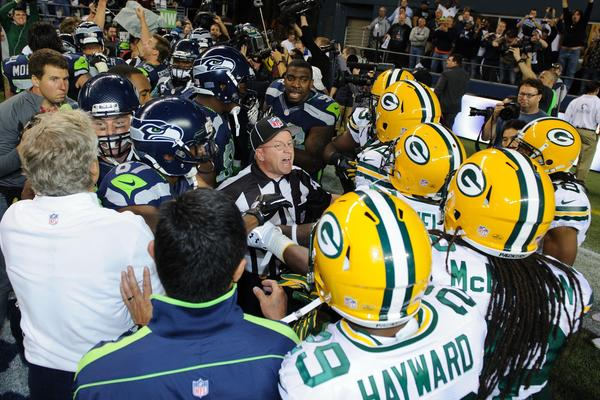 NFL referee Richard Simmons breaks up an altercation between the Seattle Seahawks and the Green Bay Packers after the game at CenturyLink Field. The much maligned replacement officials wrongly awarded the Seahawks a touchdown on the final play of the game that allowed them to beat the Packers.