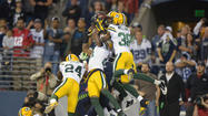 Packers interception seals win for Seattle