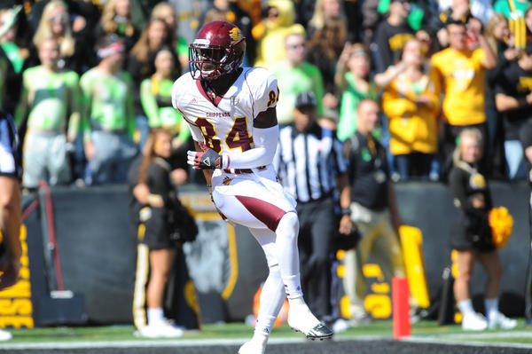 Central Michigan Chippewas wide receiver Titus Davis celebrates after scoring a touchdown in the first half of the game against the Iowa Hawkeyes.Central Michigan won the game 32-31.