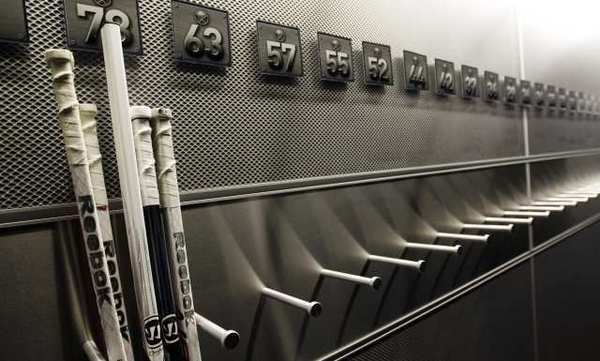 A nearly empty hockey stick rack in the Buffalo Sabres locker room.