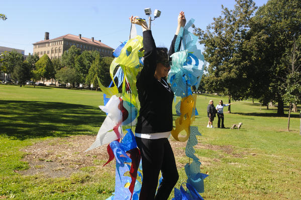 "09.25.2012 - Hartford, CT - Artists Elena Kalman hangs part of a public art installation named ""The Wave"" in Hartford's Bushnell Park. The community art project is attempting to engage participants in recognizing their connections to water as the foundation of life. Photograph by MARK MIRKO 
