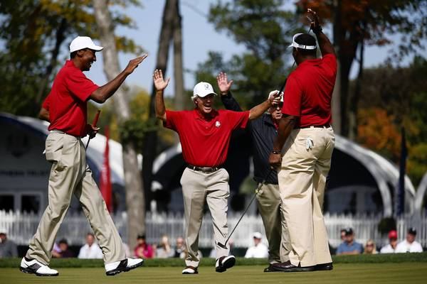 Former Chicago Bear Richard Dent, far right, celebrates after he makes a putt on the first hole at Medinah Country Club during the Ryder Cup Captain/Celebrity Pairings. Former Chicago Bulls Scottie Pippen, left, past USA Ryder Cup Team captains Ben Crenshaw and Billy Casper join the celebration.