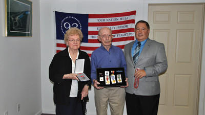 U.S. Rep. Bill Shusters aide Ron Nocco presents Telford Miller and his wife Alzene with medals Telford should have received after World War II.
