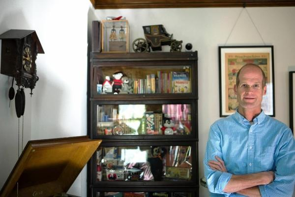 Artist Chris Ware with his eclectic collection of comic art and old items at his home in Oak Park.