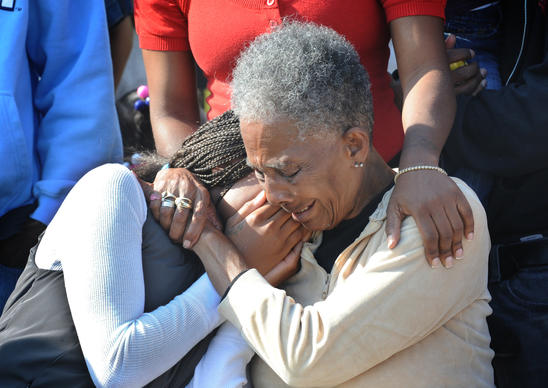 Jean Anderson, left, and her grandmother, Edith Fletcher, weep at a protest and press conference that was held at the corner of Montford Ave. and Biddle Streets protesting the death of Anthony Anderson Sr. while in police custody. Anderson, Sr. was Jean Anderson's father, and Edith Fletcher's son.
