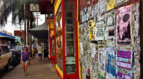 Remnants of years and years of fliers and band posters decorate a wall along Frenchmen Street in New Orleans.