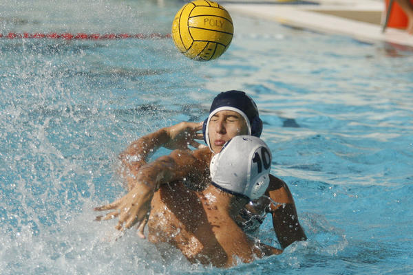 CV's Brian Dertli, bottom, throws the ball and is blocked by Pasadena Poly's Omar Dairi during a match at Pasadena Poly on Tuesday, September 25. 2012.