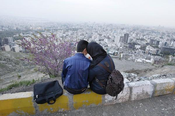 An Iranian couple enjoy some togetherness in north Tehran's mountainous area.