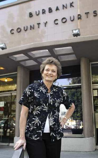 Nadine Kay Hays stands in front of the Burbank County Court house in 2008. A federal judge granted her an extension to file a complaint against the TSA at Bob Hope Airport.