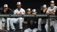 As the regular season winds down, the Orioles insist they aren't sneaking glances to right field for a peek at the out-of-town scoreboard at Camden Yards to see how the division-leading New York Yankees are doing.
