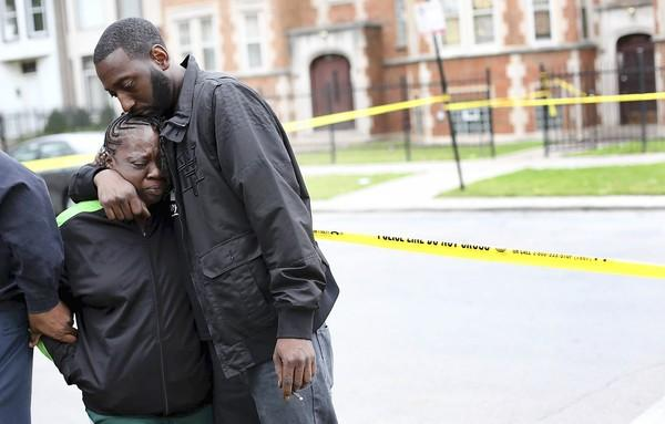 Cynthia Patterson is comforted Tuesday by Fernun Smith near the scene of a drive-by shooting that killed her daughter Quiltavia Patterson, 25, and Jermaine Carter, 38. Two others were seriously wounded.