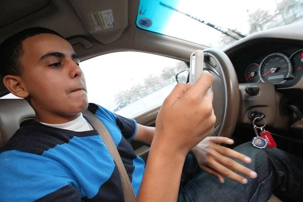 Borhan Muthana, 16, tries to text and drive on a closed course during a safety lesson. We know it's hard to kick the texting habit on the road, but dealing with the consequences of an accident can be much harder.
