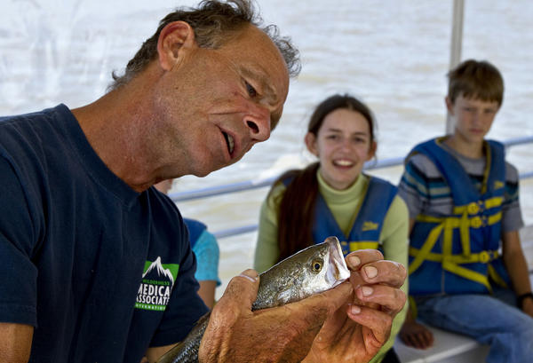 "Capt. Jimmy Sollner shows the students this Trout and the teeth. From the nets that they where using as samples of river life for teaching aids.The Chesapeake Bay Foundation has a workboat teaching lab for the students to have a floating classroom on the 50 foot boat ""Bea Hayman Clark"". St. Mary Star of the Sea Catholic School students are out on the James and Warwick Rivers for one of their floating classrooms. Learning about the area Rivers and the Chesapeake Bay."