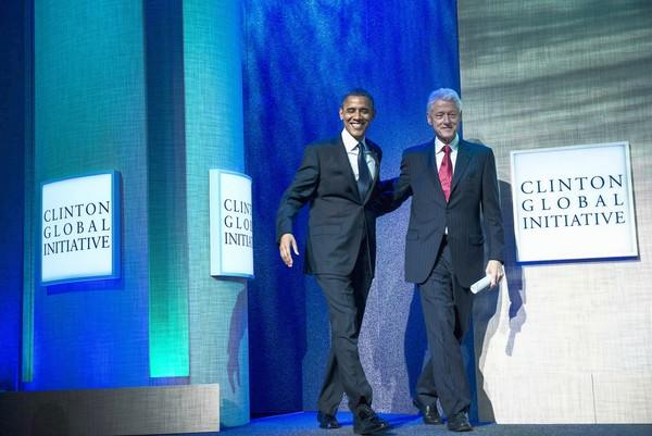 President Obama and former President Clinton arrive on stage at the Clinton Global Initiative annual meeting in New York. Obama's address focused on human trafficking.