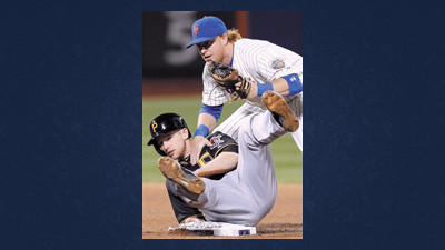 New York Mets second baseman Justin Turner gets tangled up after catching Pittsburgh Pirates' Alex Presley stealing in the fourth inning of their baseball game at Citi Field in New York, Tuesday.
